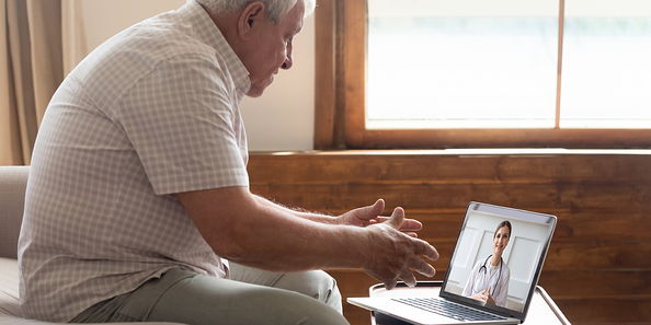 Patient having a televisit appointment with his doctor on the iPad