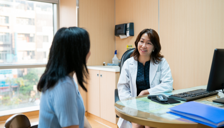 A primary care provider actively listening to a patient