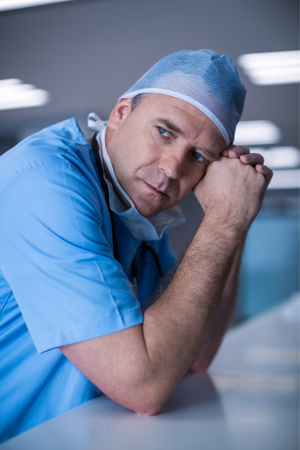 Weary Doctor contemplating office inefficiency