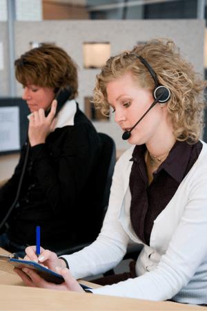 Front desk of a medical office taking calls