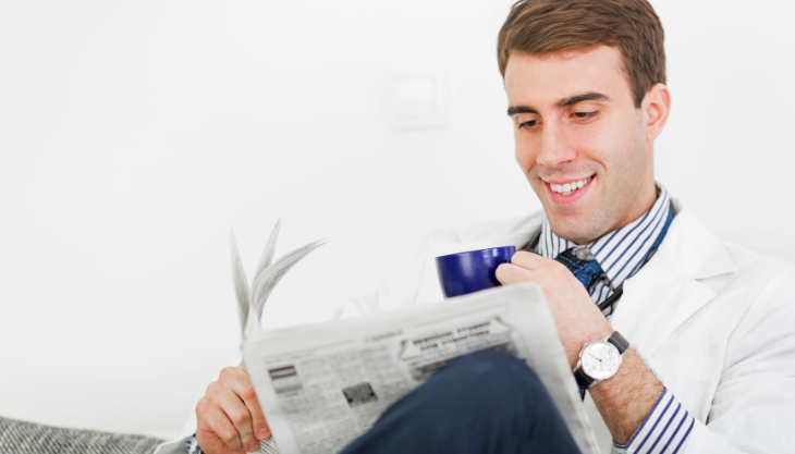 A primary care physician reading healthcare news