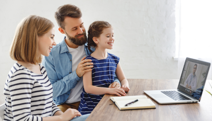 Family on a Telehealth videochat with a doctor