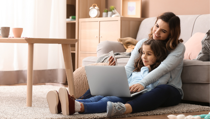 new normal, mother and daughter in a living room, working remotely