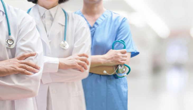 healthcare providers, hospital staff standing in a row, HCWs with stethoscopes