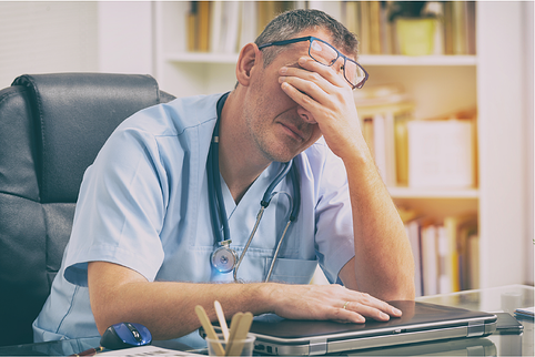 Provider very tired at his desk