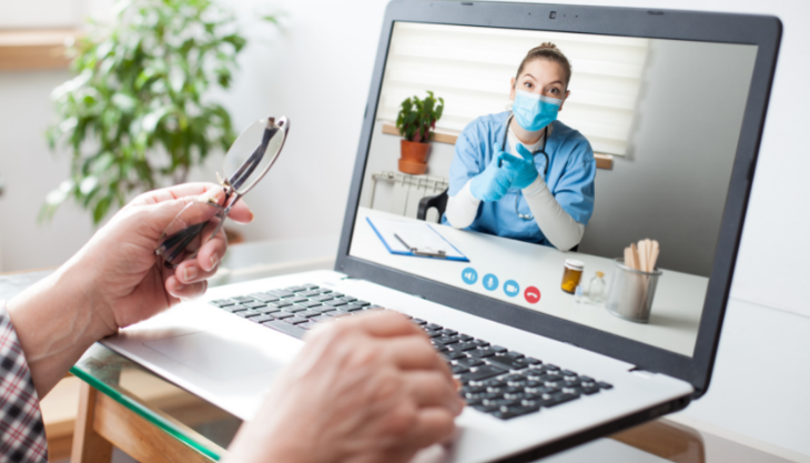 Patient on a telemedicine virtual call with their doctor.