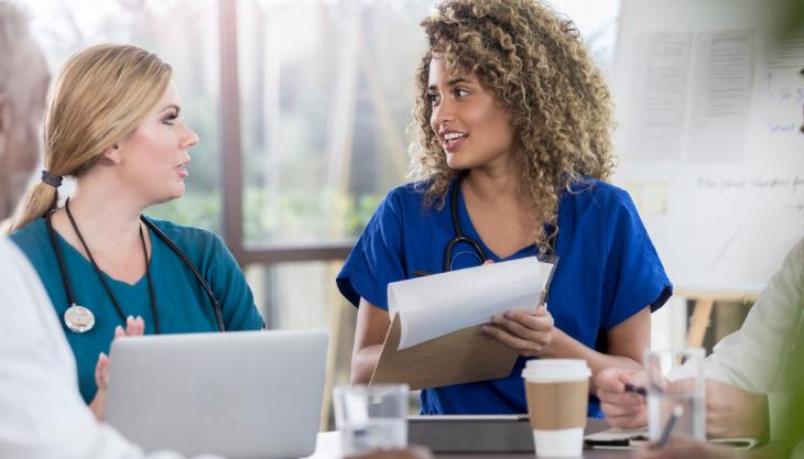Nurse asking a peer for EHR advice