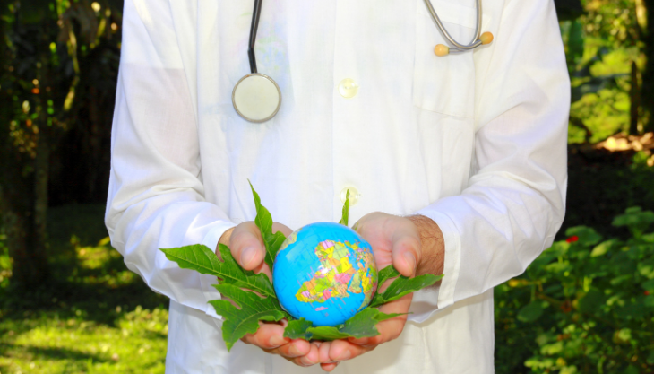 Eco-friendly doctor holding a globe.