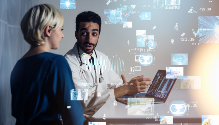 Doctor showing a patient either an EHR or an EMR
