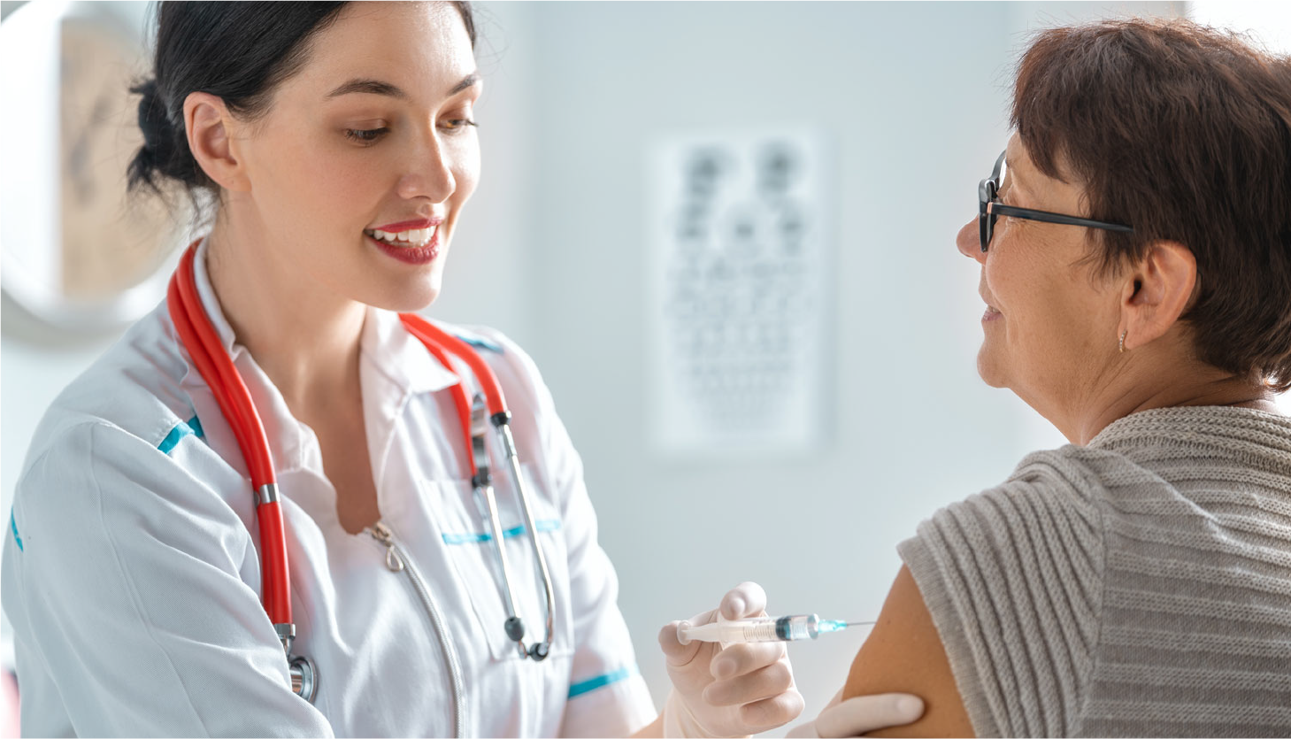Patient Receiving an injection into the arm by her provider