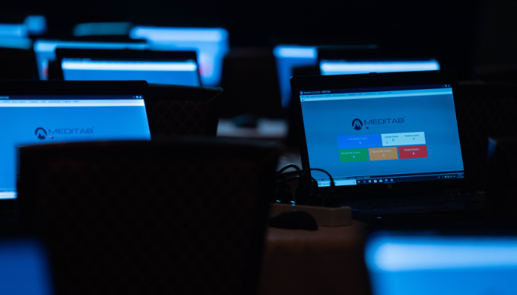 Meditab Displayed on a Bank of Computers for a Virtual Summit