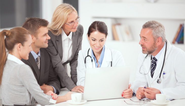 Staff of a Medical Clinic Discuss the Business Strategies for Their Practice