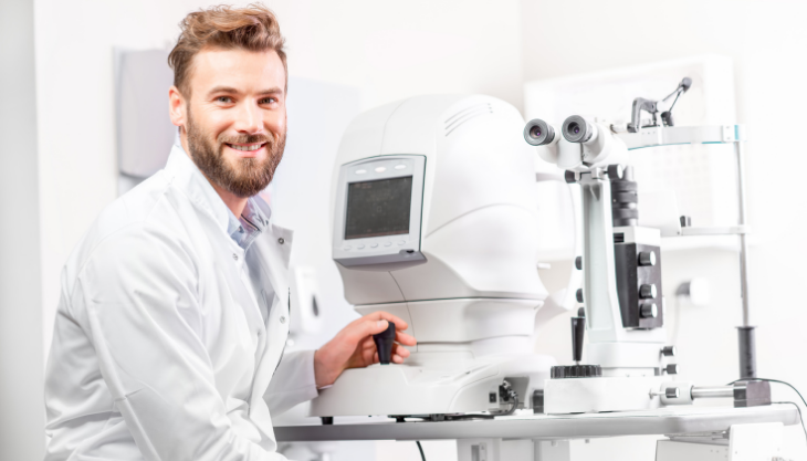 An Ophthalmologist Sitting at a Diagnostic Machine Before Starting Billing